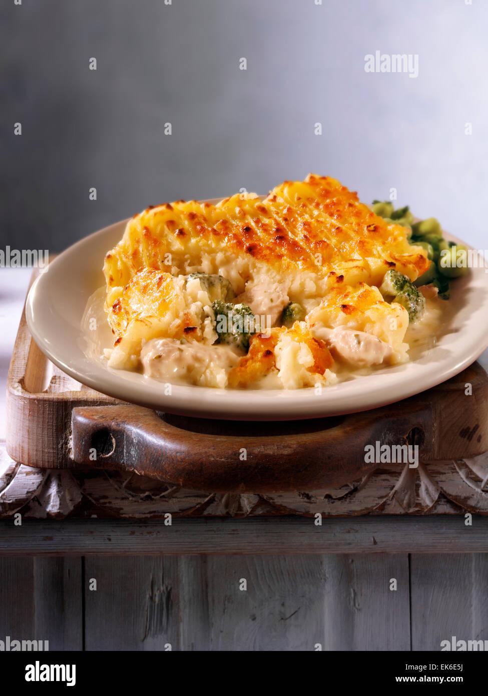 Cooked chicken & broccoli potato pie recipe - Stock Image