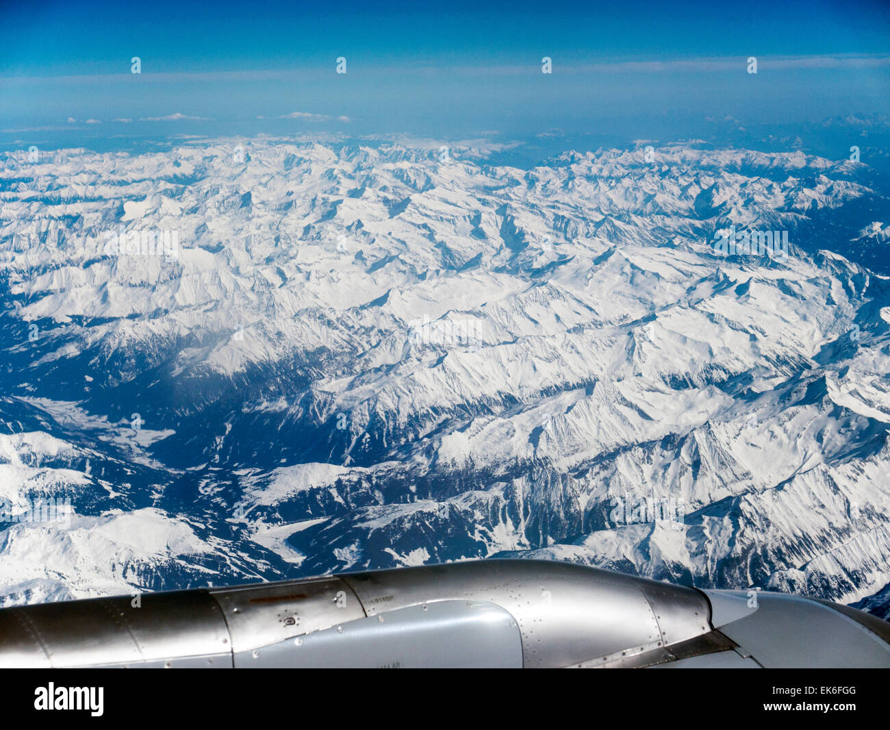 Daytime winter view of the Alps from commercial jetliner - Stock Image