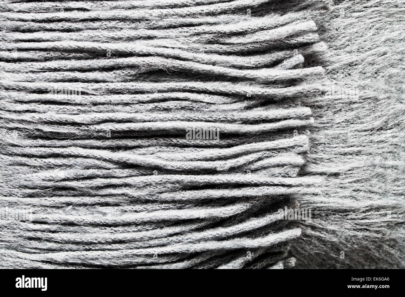Close up fo the tassels of a wool scarf - Stock Image