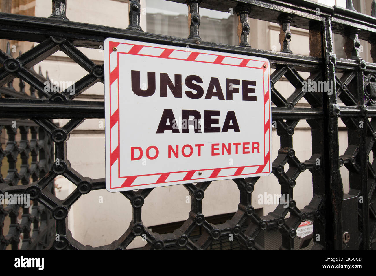 unsafe area, do not enter sign on railings in London UK - Stock Image