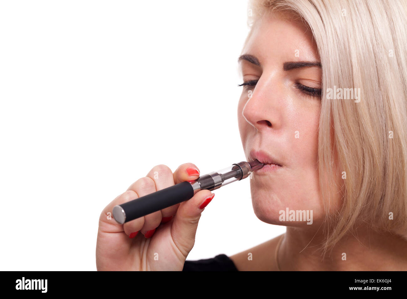 Close up Serious Facial Expression of a Young Blond Woman Smoking Using E- Cigarette on a White Background - Stock Image