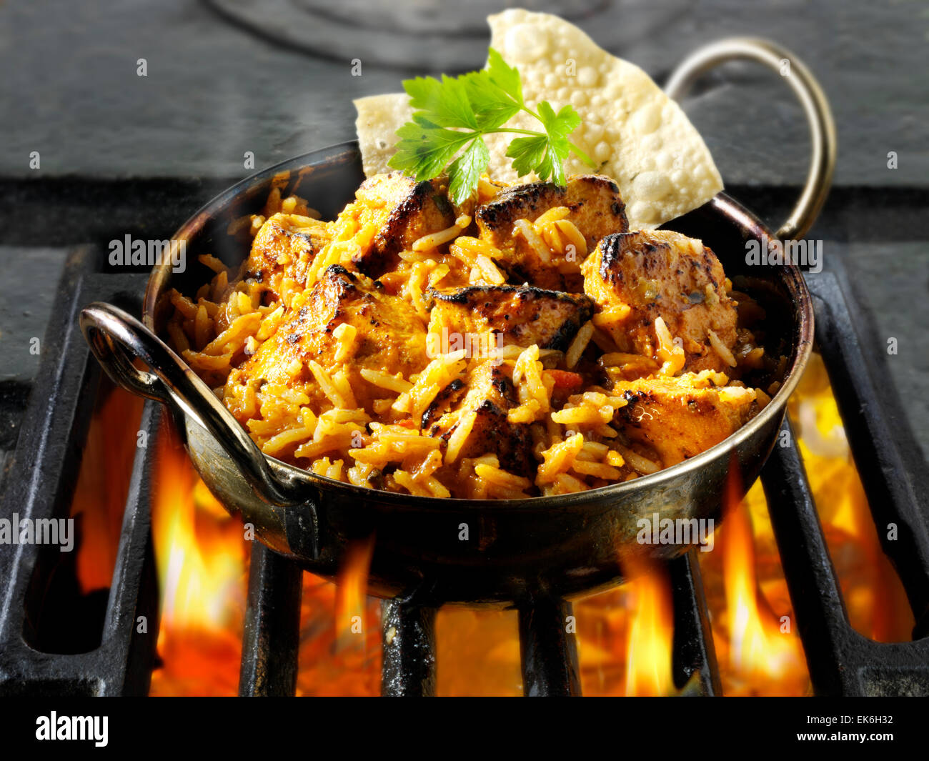 Chicken Tikka Byriani being cooked in a pan.  Indian food recipe. - Stock Image