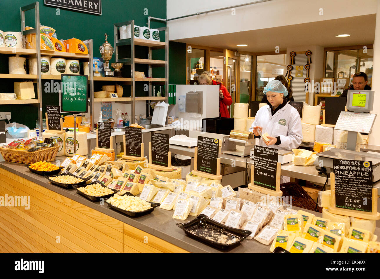 The sales counter selling cheeses, The Cheese shop, Wensleydale Creamery, Hawes, North Yorkshire Dales, England Stock Photo