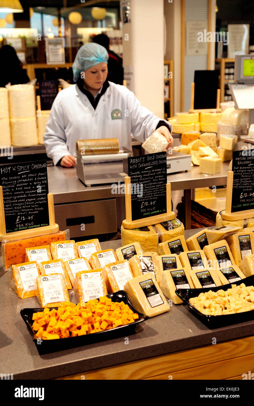 Staff selling cheeses in the cheese shop, Wensleydale Creamery, Hawes, Yorkshire Dales England UK - Stock Image