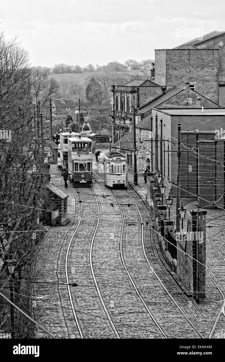 Black & White: Tramway Village - a driver exits Tram 40: Blackpool 1926; while an engineer checks the track - Stock Image