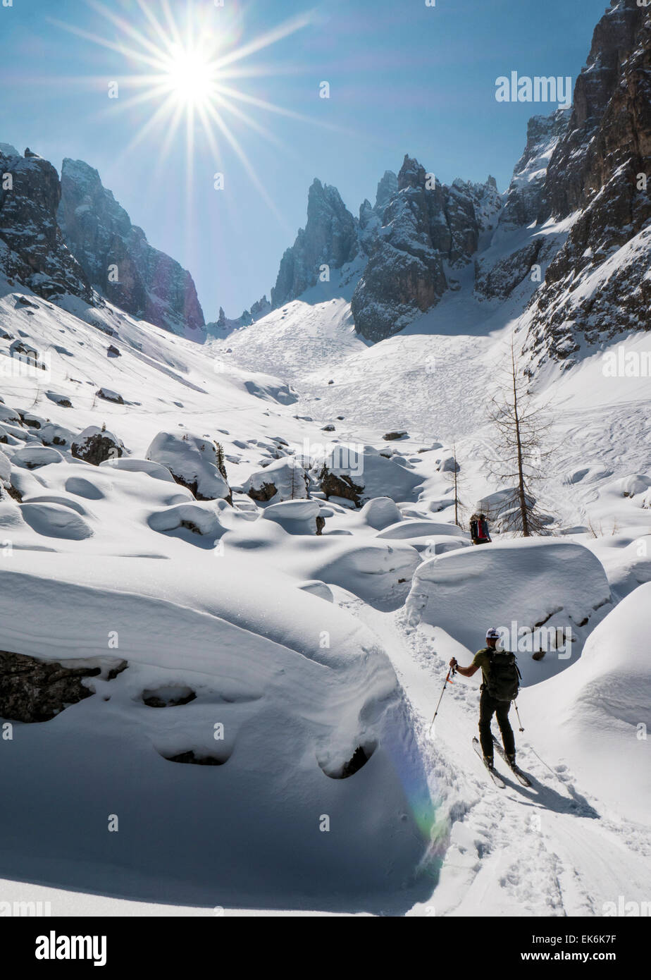 Backcountry skiers, northeast of Cortina, Dolomite Mountains, Alps, Italy - Stock Image