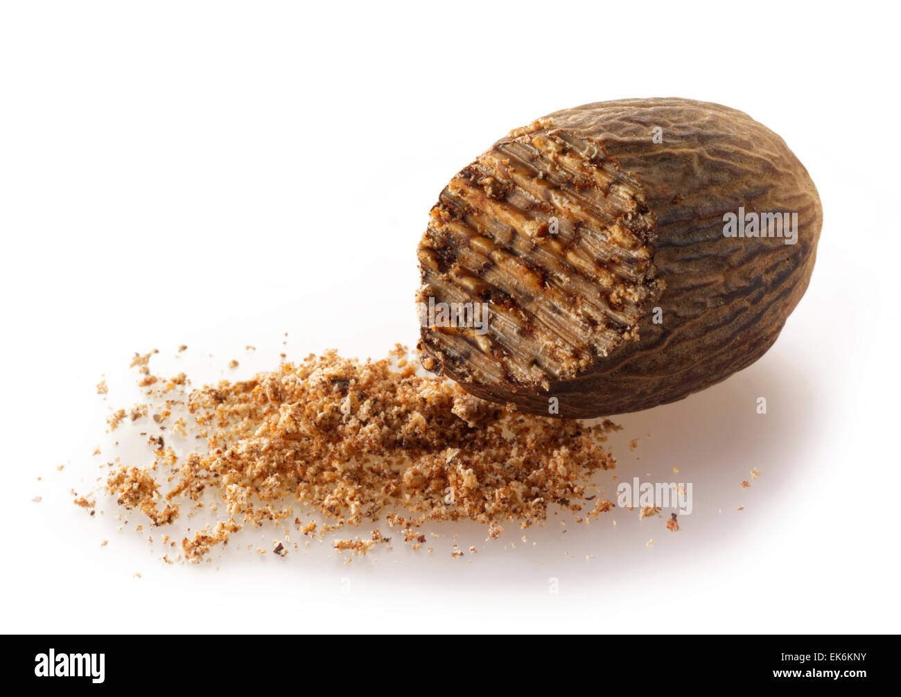 Whole fresh Nutmeg with ground nutmeg (Myristica fragrans)  composed arrangement isolated against a white background - Stock Image