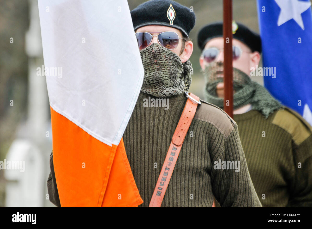 Men dressed in Irish paramilitary uniforms, with their faces