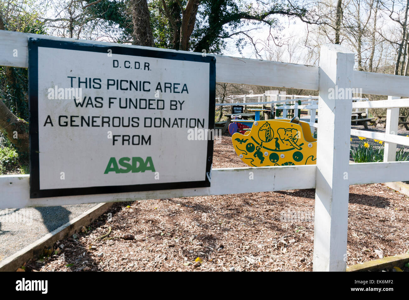 Sign 'This picnic area was funded by a generous donation from Asda' - Stock Image