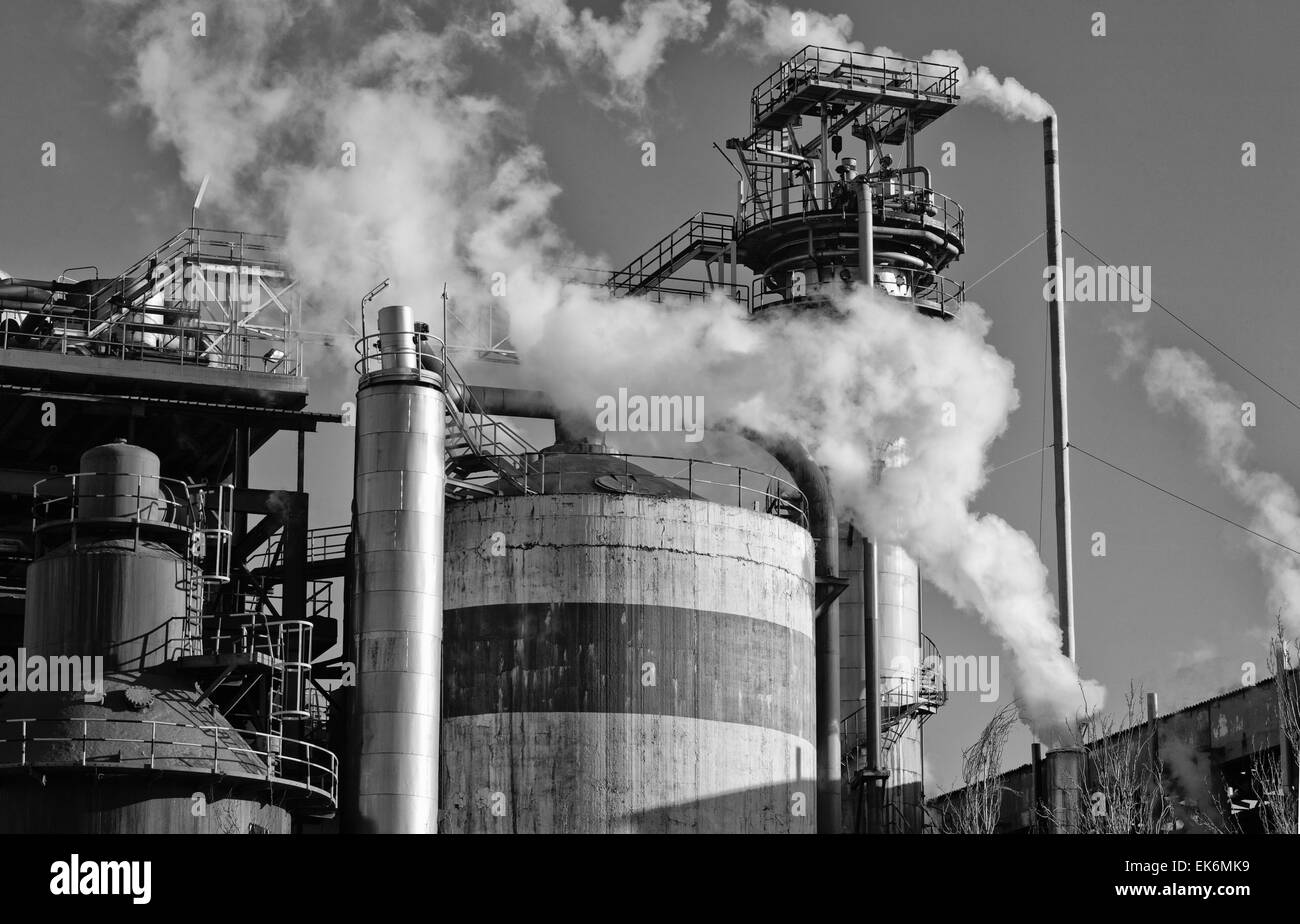 This is an example of air pollution at work. An smokestack take out smoke at a cellulose factory. Air pollution - Stock Image