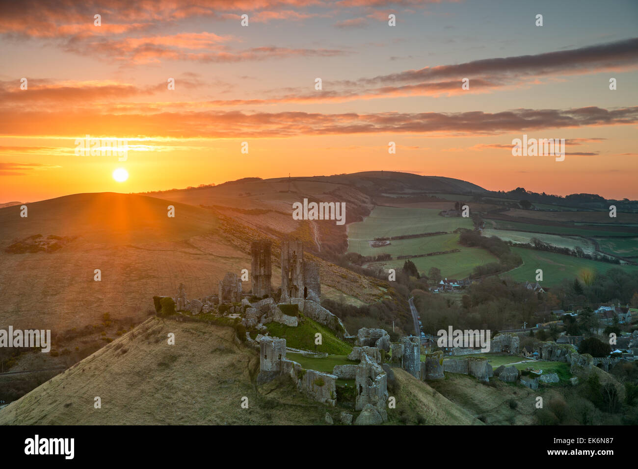 Sunrise over the iconic ruins of Corfe Castle in Dorset - Stock Image