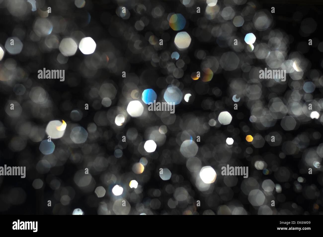 Abstract  bokeh. Blurred water drops backlit. Levitation of rain drops defocused - Stock Image