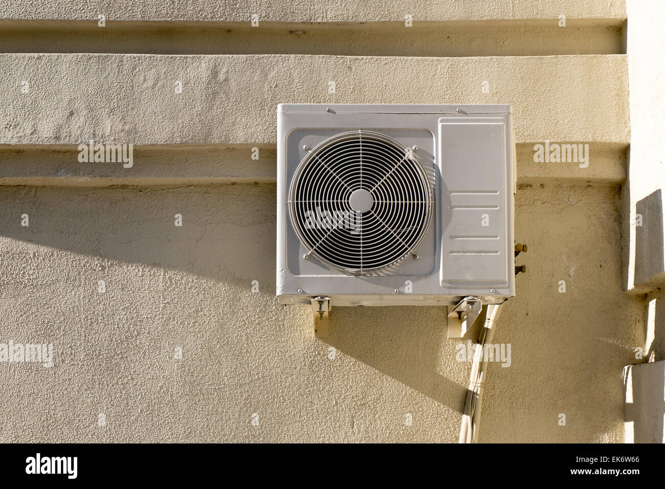 Air conditioner on the wall outdoors in summer. A lot of copyspace near system. Stock Photo