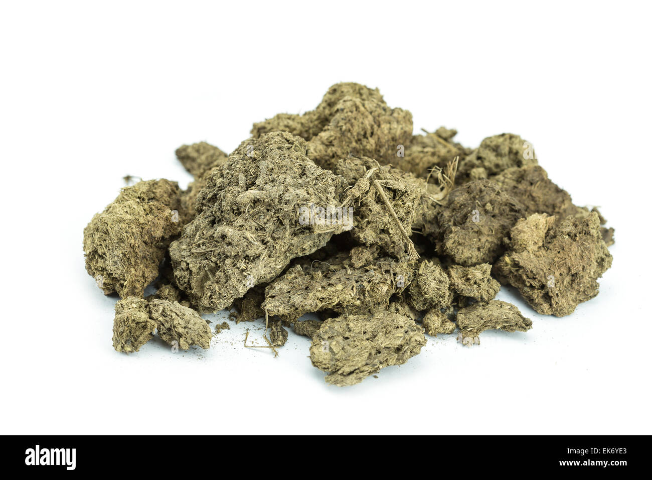 Pile of dry cow manure isolated on white background Stock Photo