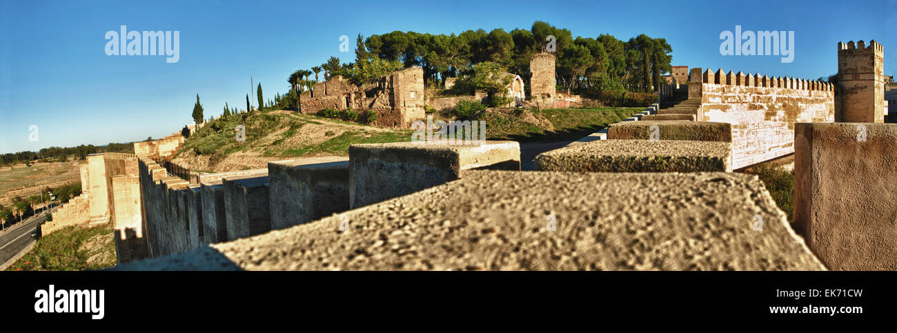 Battlements, pathways and towers of Badajoz muslim wall. Adarve and inside buildings. HDR - Stock Image