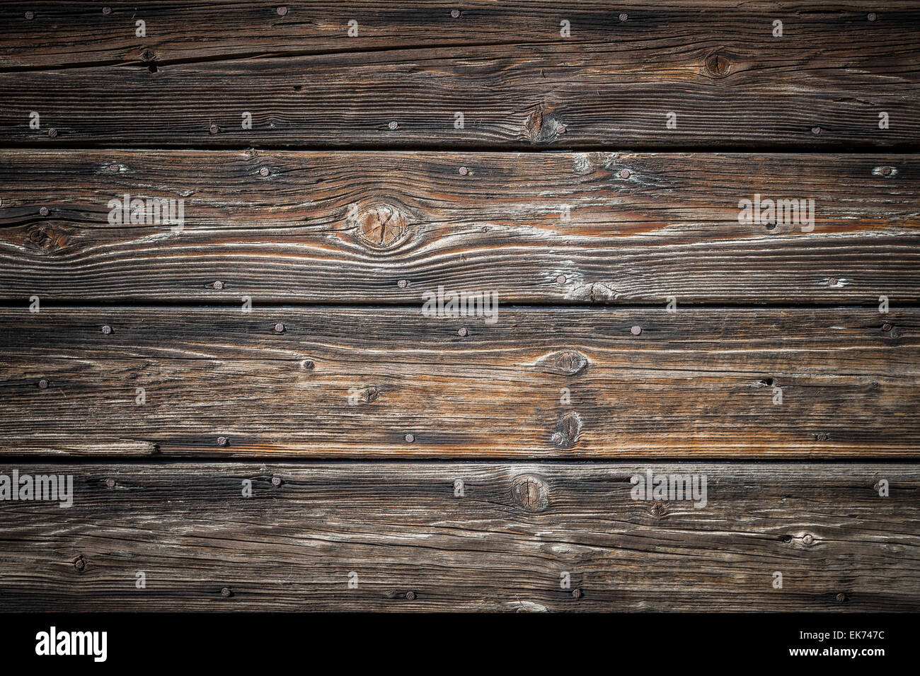 Wood background with brown tones and black parts. Stock Photo
