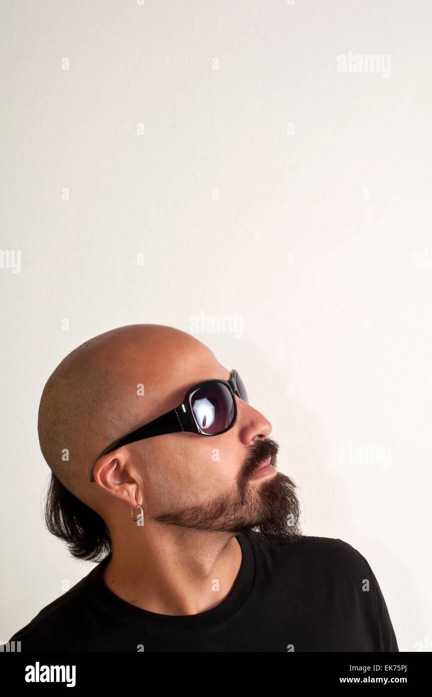 blacks man with glasses, beard and black jacket Stock Photo
