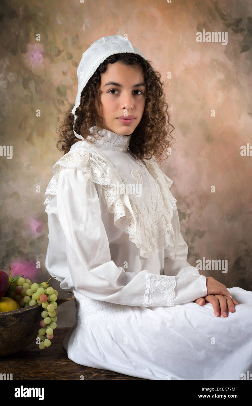 Young lady posing for an old style victorian portrait Stock Photo