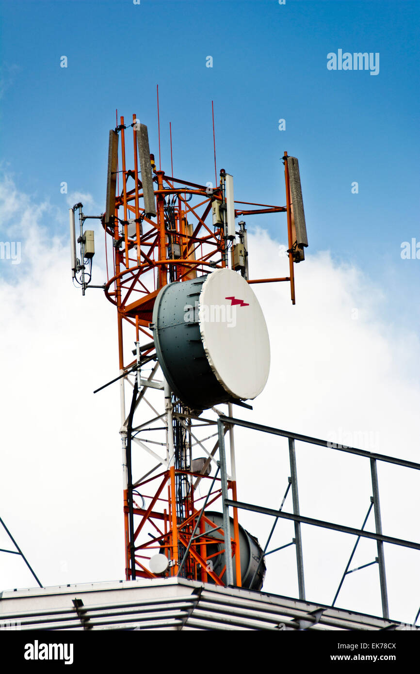 tower of huge antennas for cellular and mobile telecommunication - Stock Image