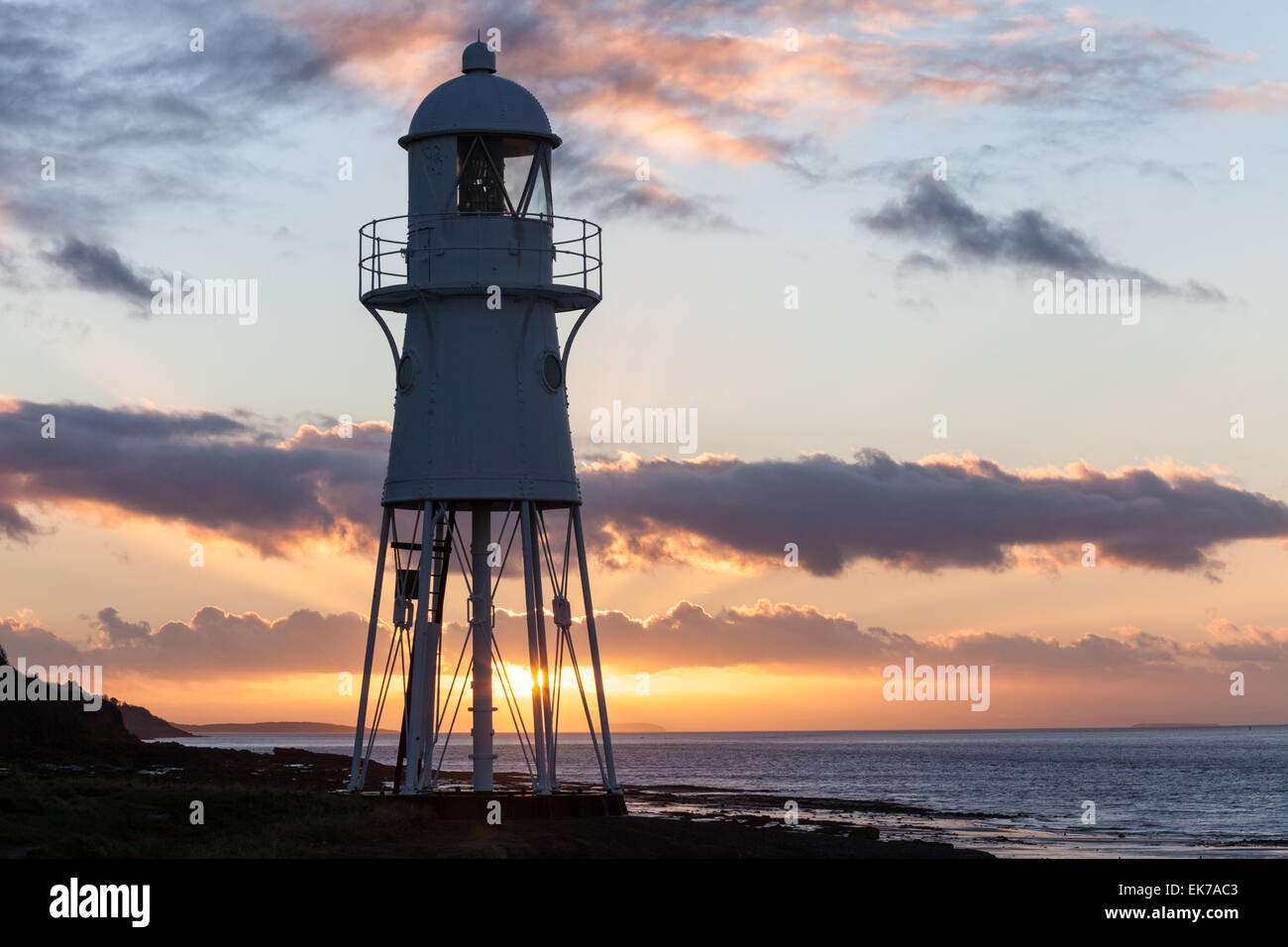 Sunset at the Black Nore Lighthouse in North Somerset, England - Stock Image