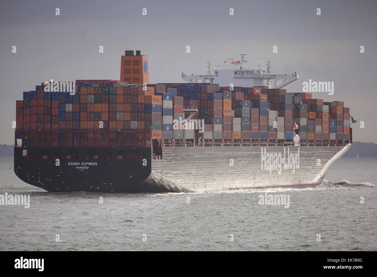 The cargo ship, Essen Express, departing Southampton Water in the Solent. - Stock Image