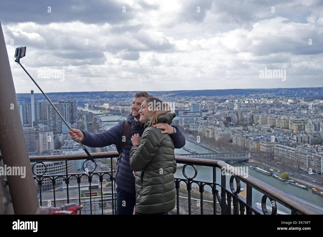 A couple take a 'selfie' on the Eiffel Tower in Paris - Stock Image