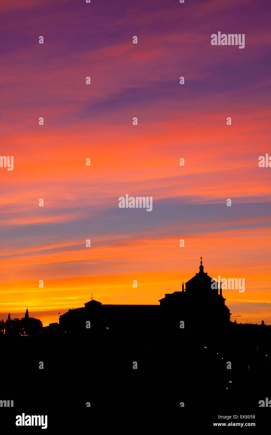 Silhouette of catholic church in sunset. - Stock Image