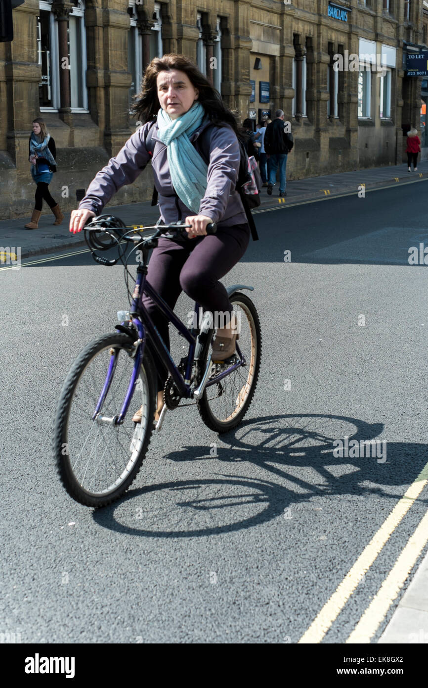 Young lady cycling in Salisbury Wiltshire - Stock Image