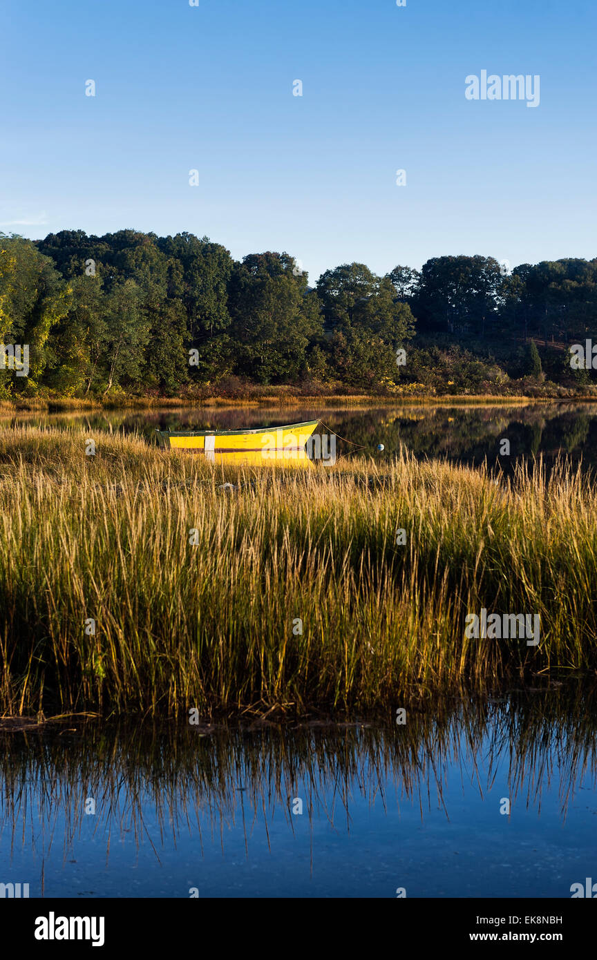 Rowboat anchored in a coastal inlet. Stock Photo
