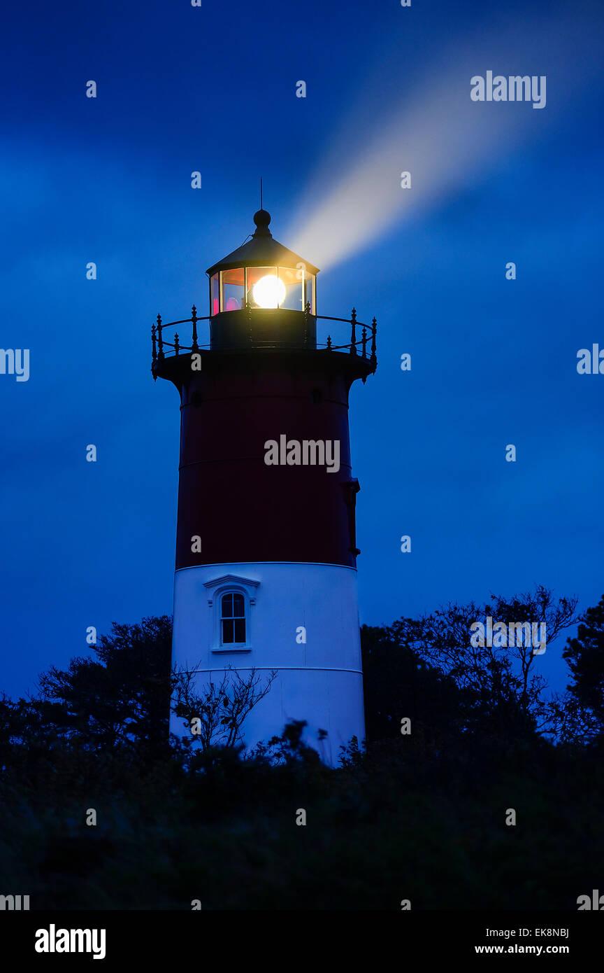 Nauset Light shines during a stormy night, Cape Cod National Seashore, Eastham, Cape Cod, Massachusetts, USA - Stock Image