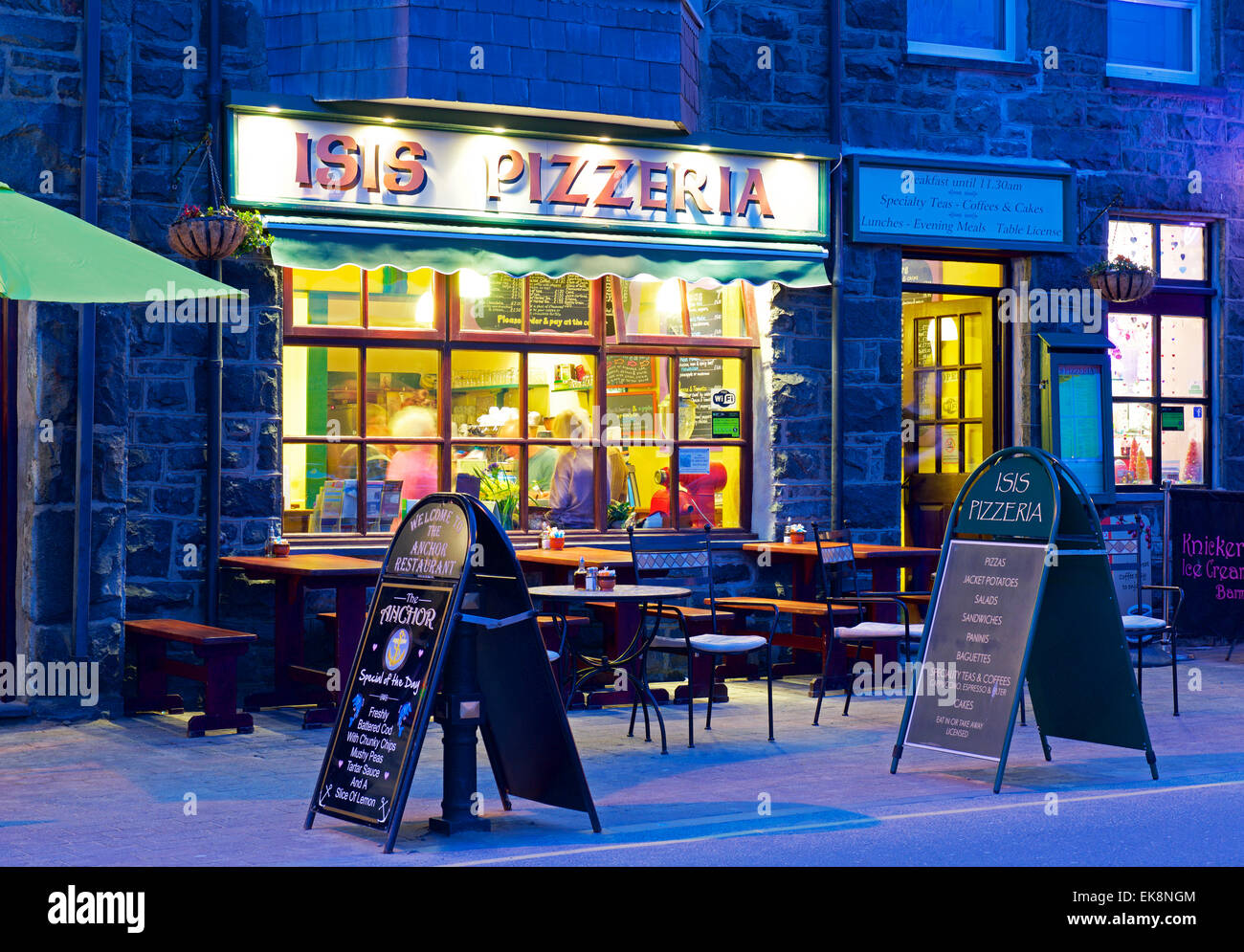 The Isis Pizzeria at night, Barmouth, Gwynedd, Wales UK - Stock Image