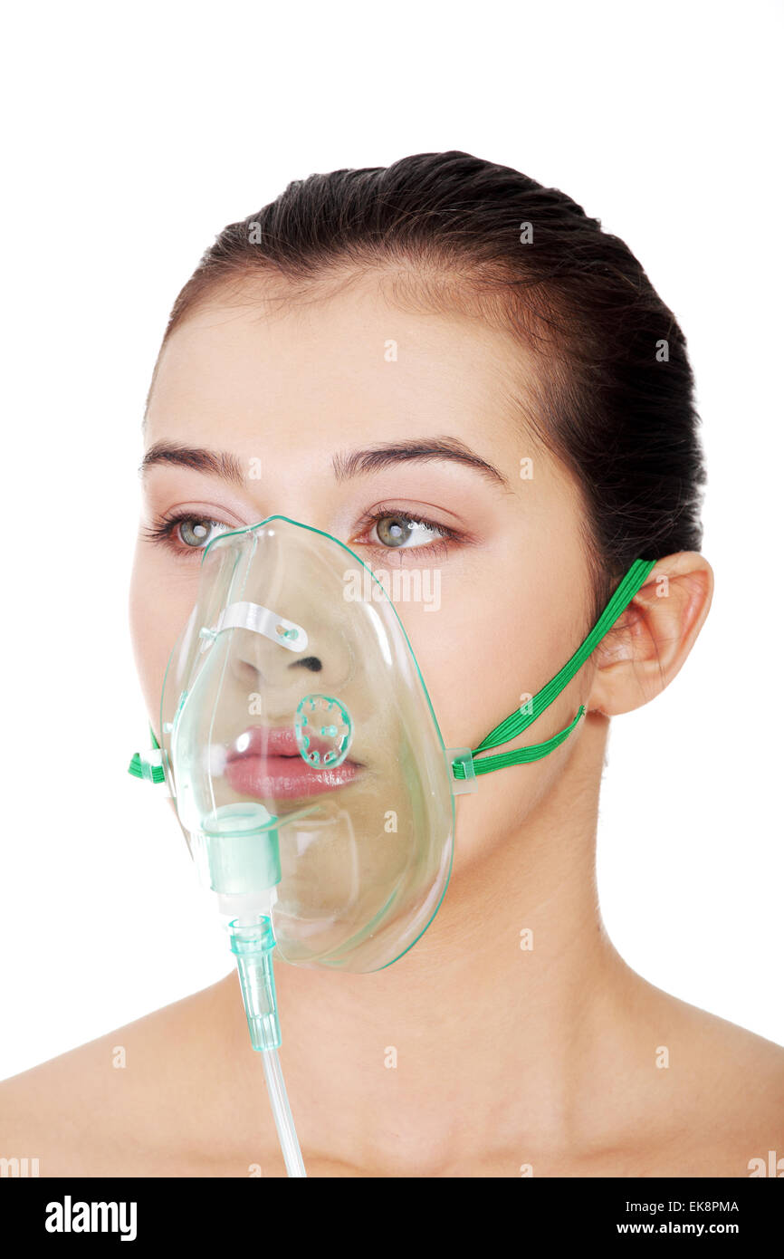 Diseased female patient wearing a oxygen mask - Stock Image