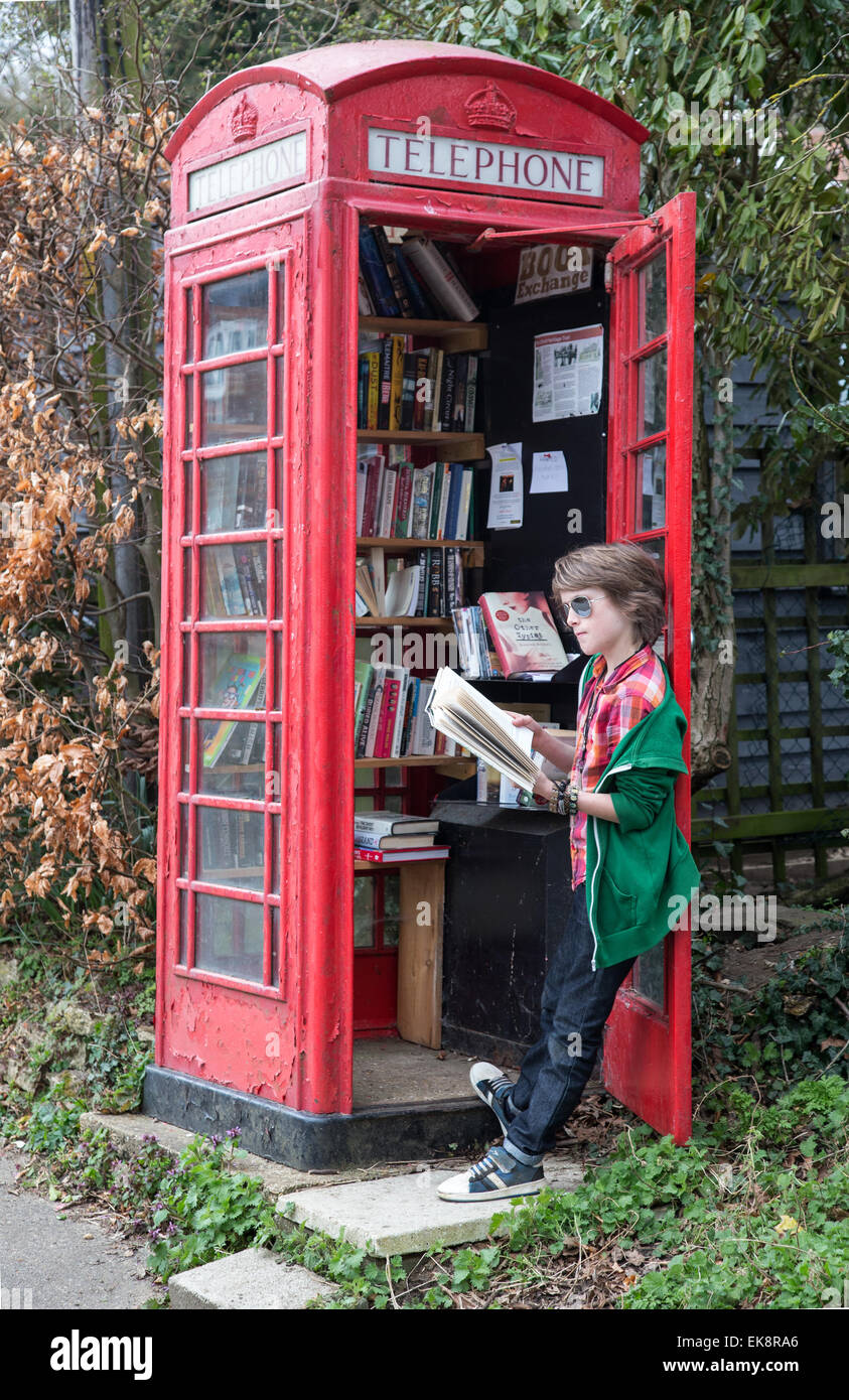 K6 Red telephone box, designed by Sir Giles Gilbert Scott,used as a lending library in a Suffolk village - Stock Image