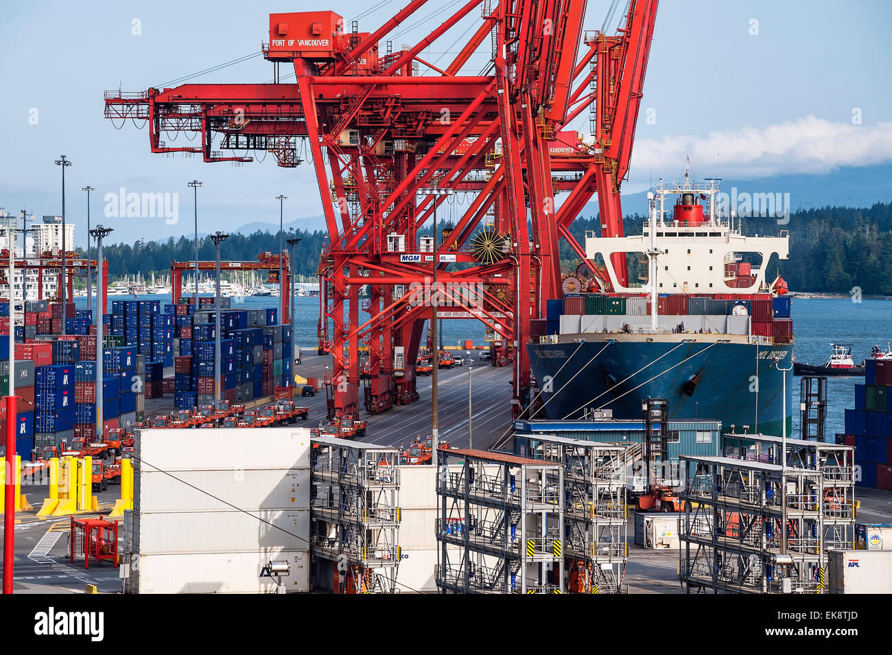 Docked cargo ship being loaded with  containers for export, Vancouver, British Columbia, Canada - Stock Image