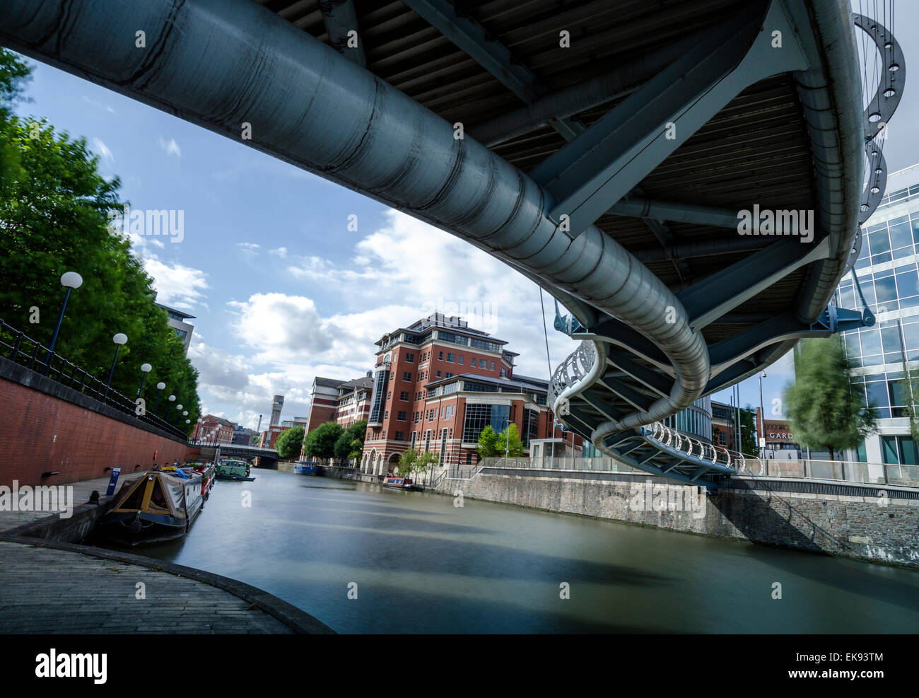 The snaky shape of Valentine's Bridge shot from below in the Temple Quay area of Bristol. Long exposure. - Stock Image