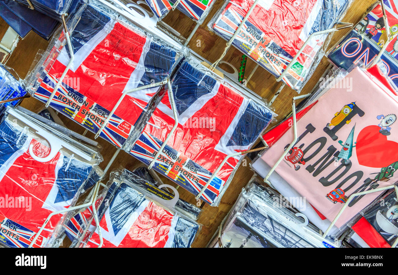 An image of various tee shirts for sale in Covent Garden Market  London - Stock Image