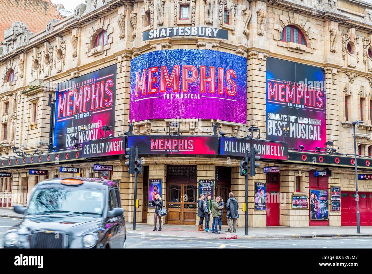 A landscape image of the Shaftesbury Theatre featuring Memphis The Musical and a passing black taxi cab - Stock Image