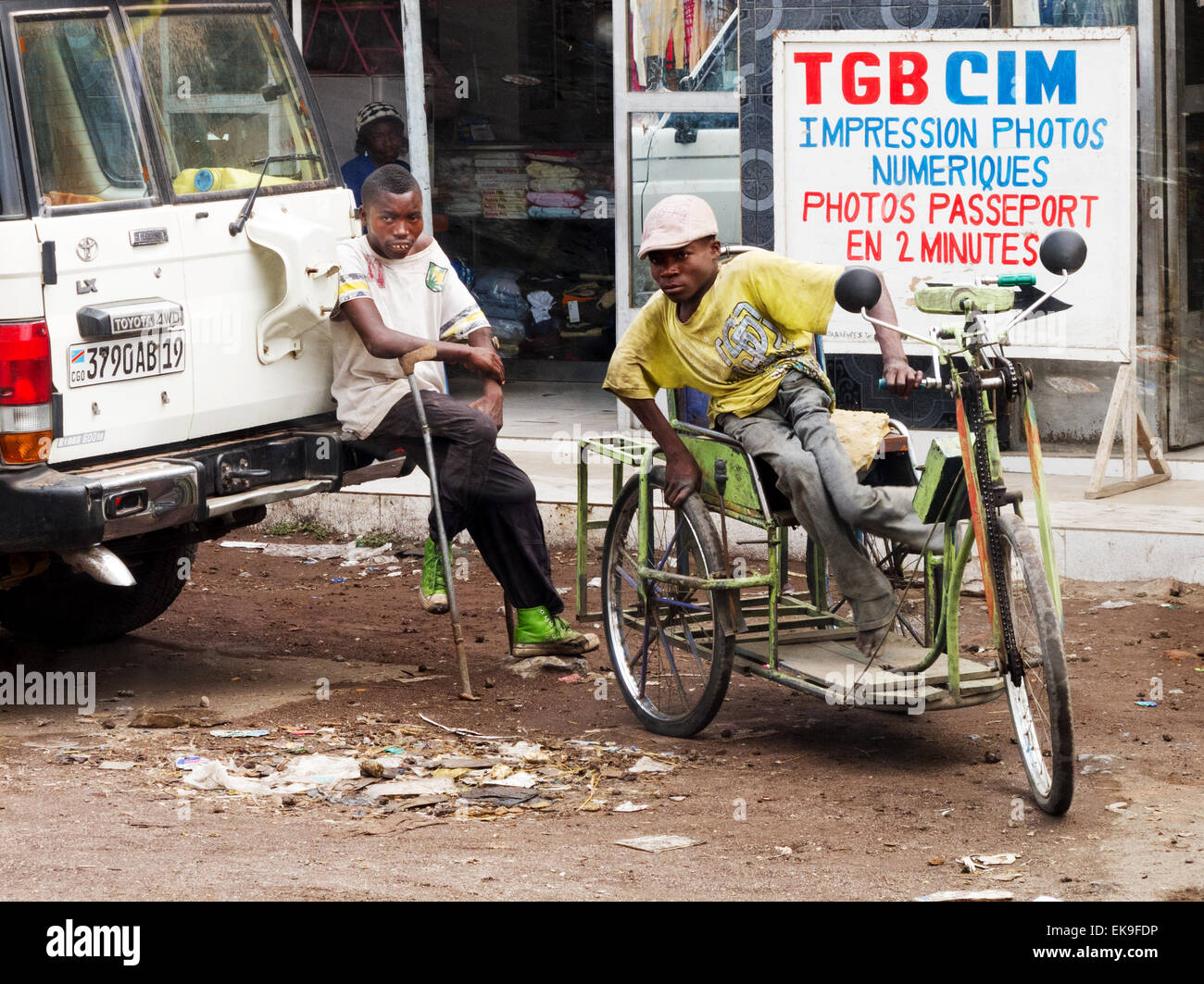 Disabled people, one in a wheelchair, Goma, Democratic Republic of Congo ( DRC ), Africa - Stock Image