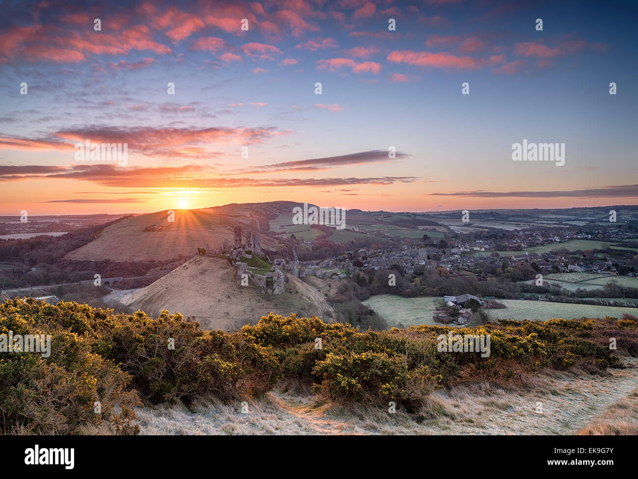 Beautiful dramatic sunrise over Corfe Castle in Dorset - Stock Image