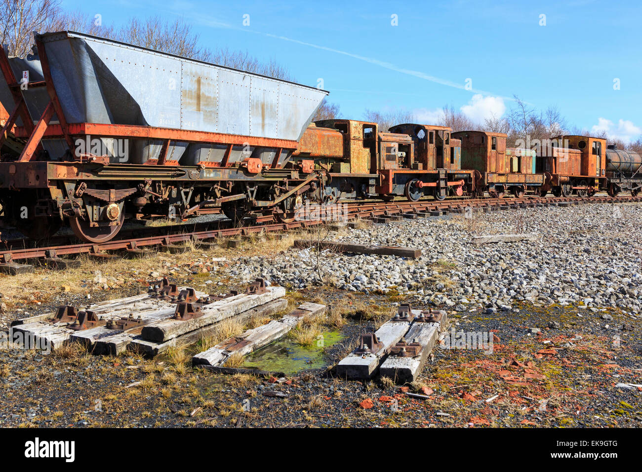 Old and abandoned rusting steam trains and railway carriages, Ayrshire, Scotland, UK - Stock Image