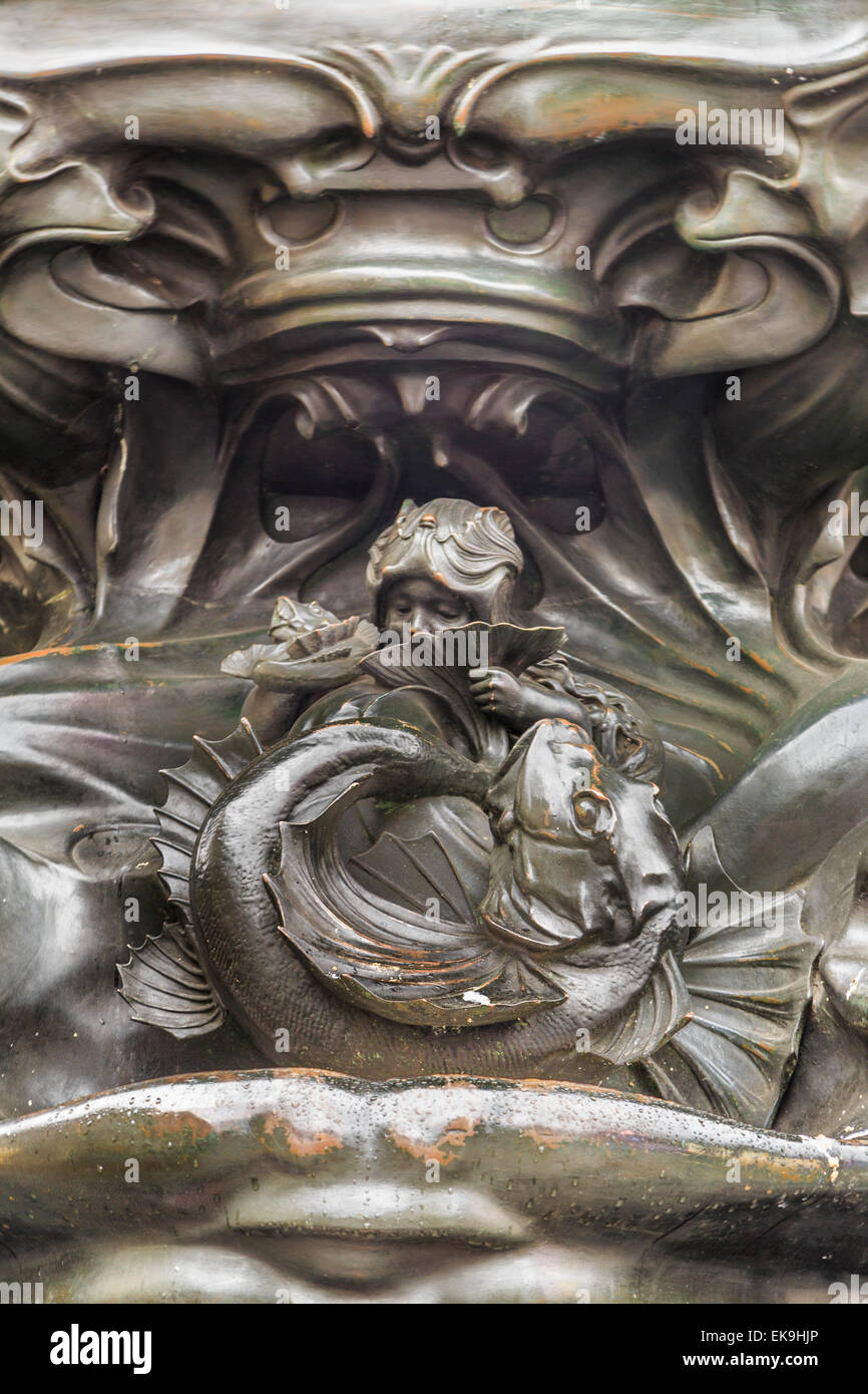 A vertical close up of the bronze marine motifs of the Shaftesbury Memorial Fountain Piccadilly Circus London - Stock Image