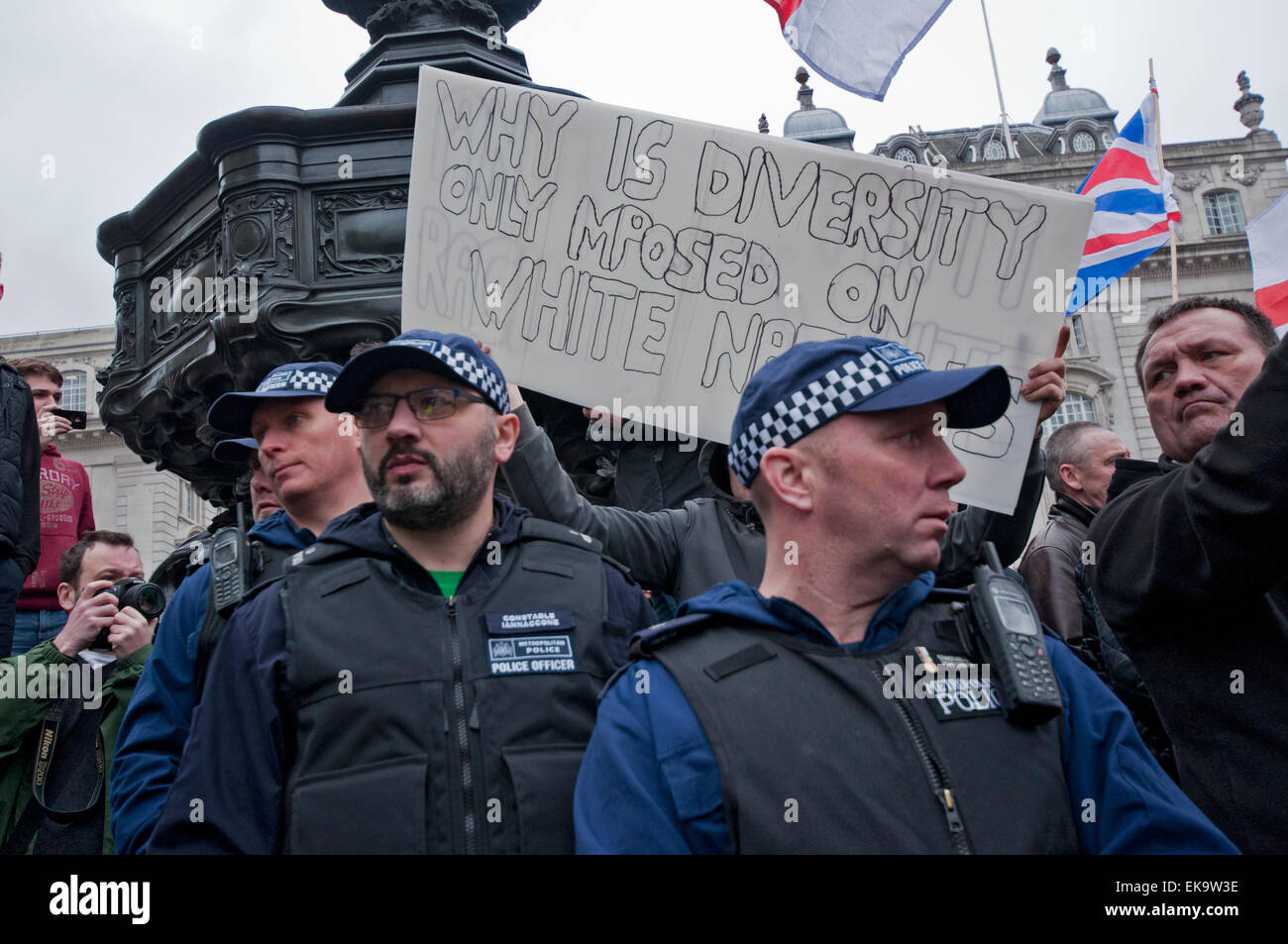 Police surround group from Britain First as they try to disrupt  UN Anti-Racism Day protesting Racism, Fascism, - Stock Image