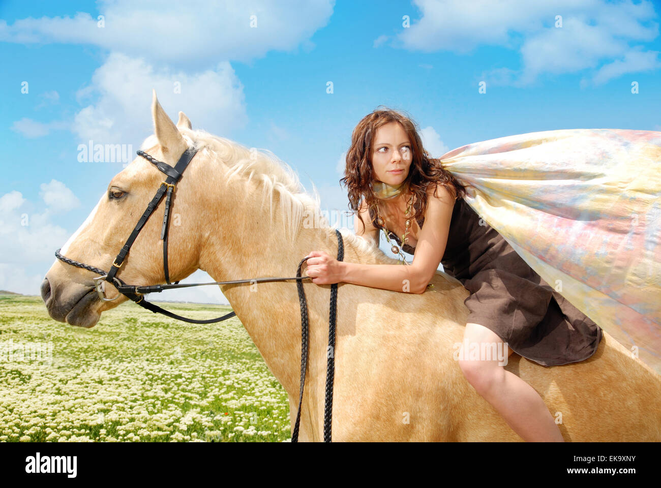 Escaping on a horseback - Stock Image