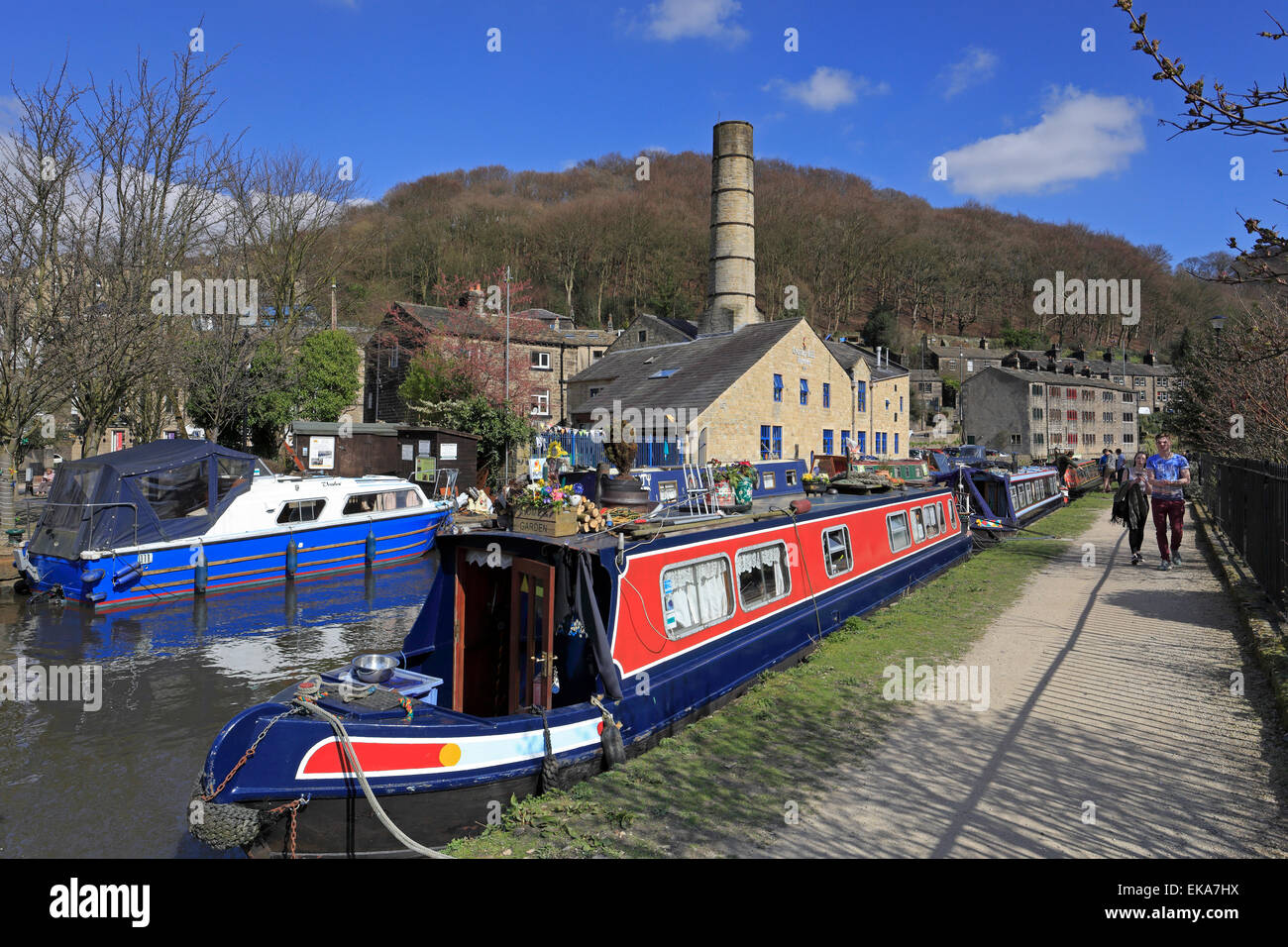 Narrow boats along the Rochdale Canal at Hebden Bridge, West Yorkshire, England, UK. - Stock Image