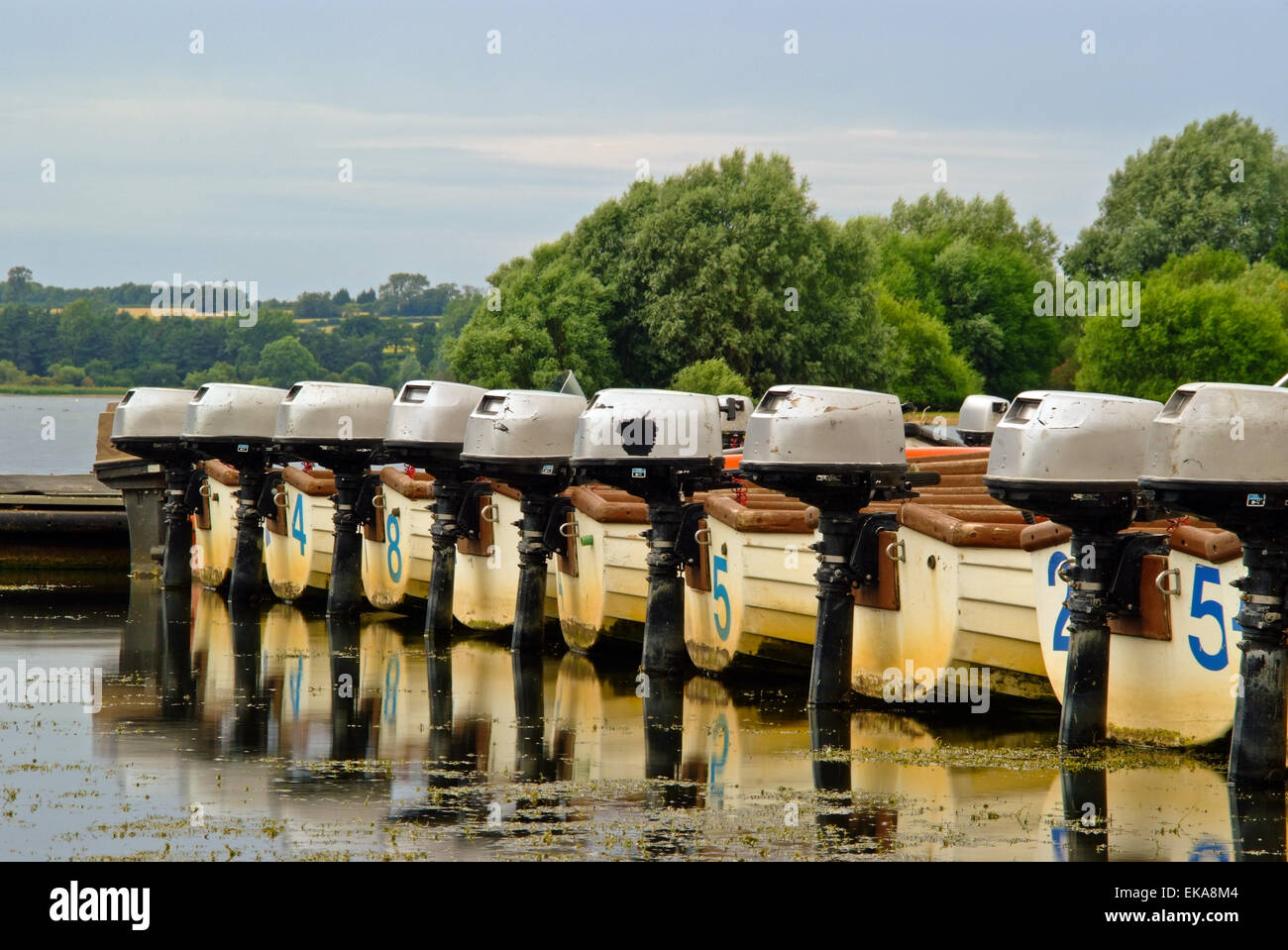 Line of fishing boats with outboard motors - Stock Image