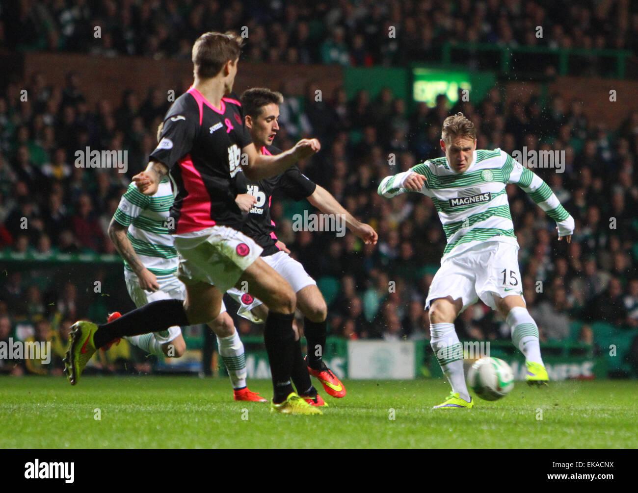 Glasgow, Scotland. 08th Apr, 2015. Scottish Premier League. Celtic versus Partick Thistle. Kris Commons shoots from - Stock Image