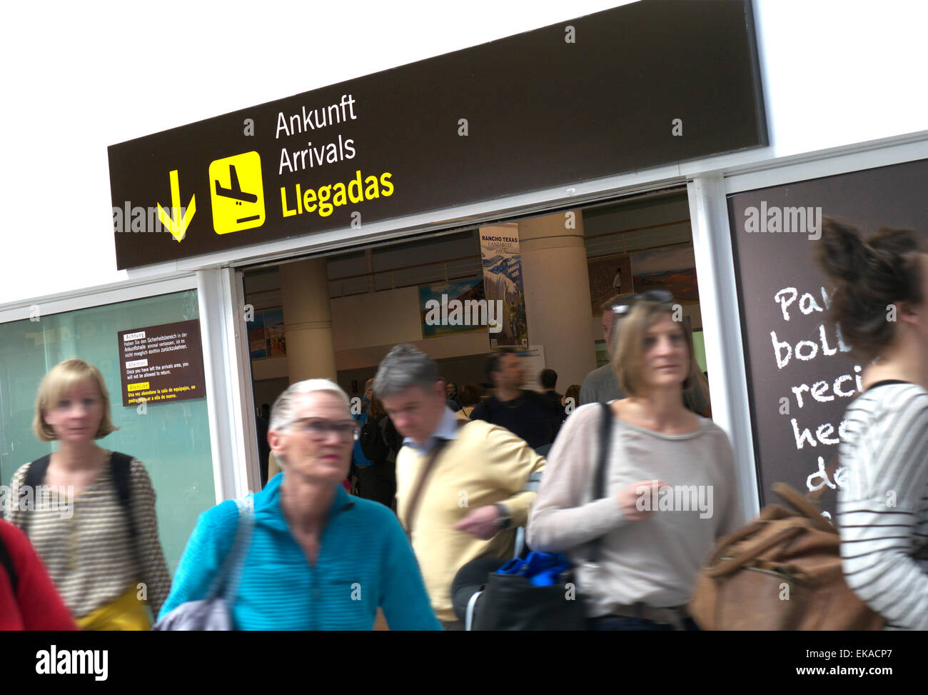 Airline passengers arriving at busy Lanzarote airport arrivals hall Canary Islands Spain - Stock Image