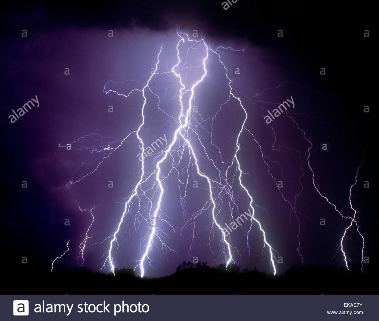 Lightning strikes in the desert north of Tucson Arizona in a summer monsoon type thunderstorm. Stock Photo