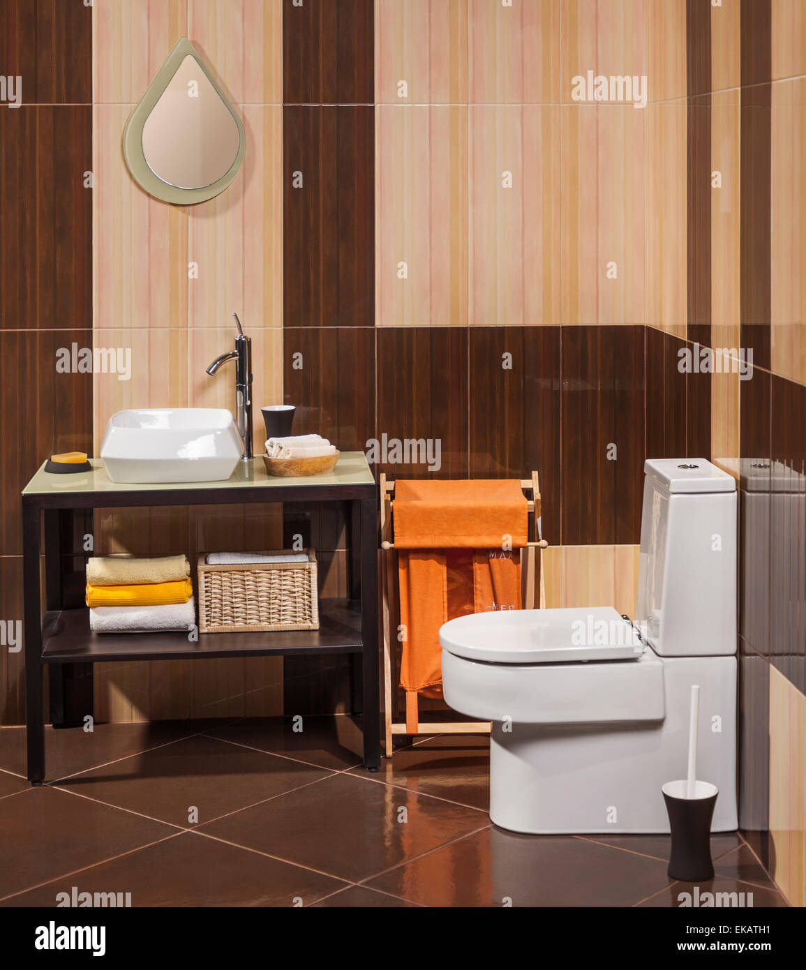 detail of a modern bathroom with sink, toilet and laundry basket - Stock Image