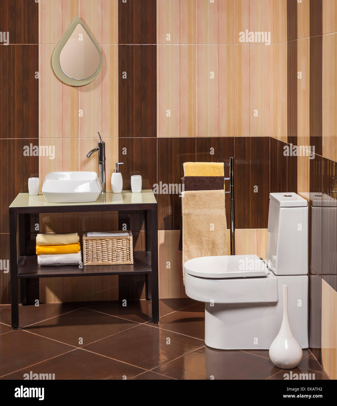 detail of a modern bathroom with sink, toilet and towel - Stock Image